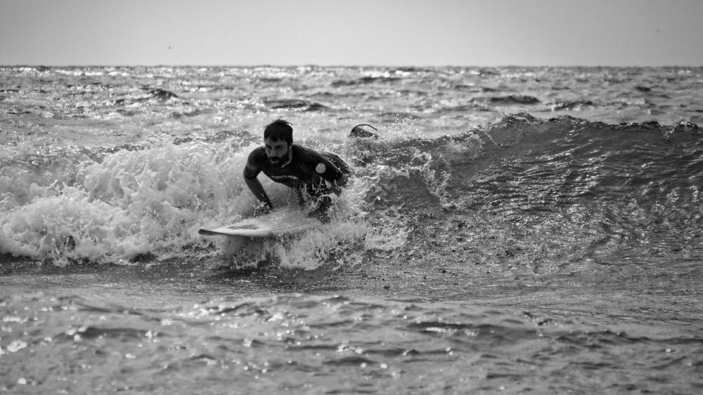Alessio Buccino from the Summer School tests the waters of San Diego. Photo: Christopher Villongco, UCSD