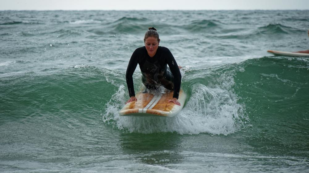 Viviane Timmermann rides the waves in San Diego. Photo: Christopher Villongco, UCSD