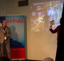 Dr. Kyrre Lekve (Simula) and Professor Katrin Franke (NTNU) at the opening of the 2017 Cyber Security Seminar. Photo: Simula