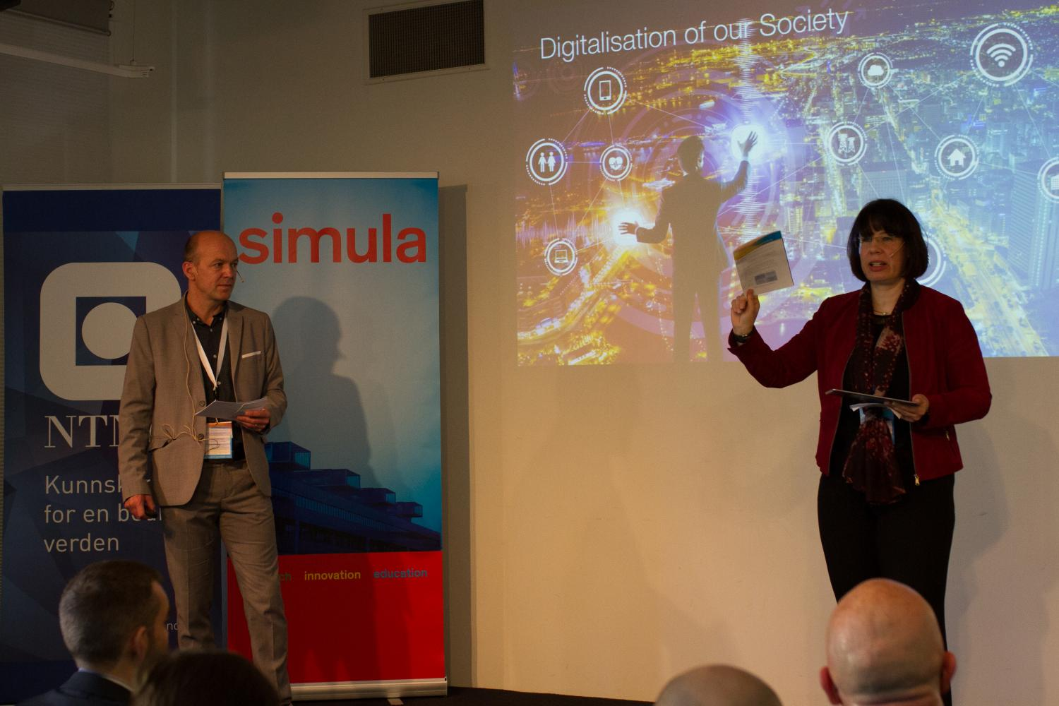 Dr. Kyrre Lekve (Simula) and Professor Katrin Franke (NTNU) at the opening of the 2017 Cyber Security Seminar. Photo: Simula