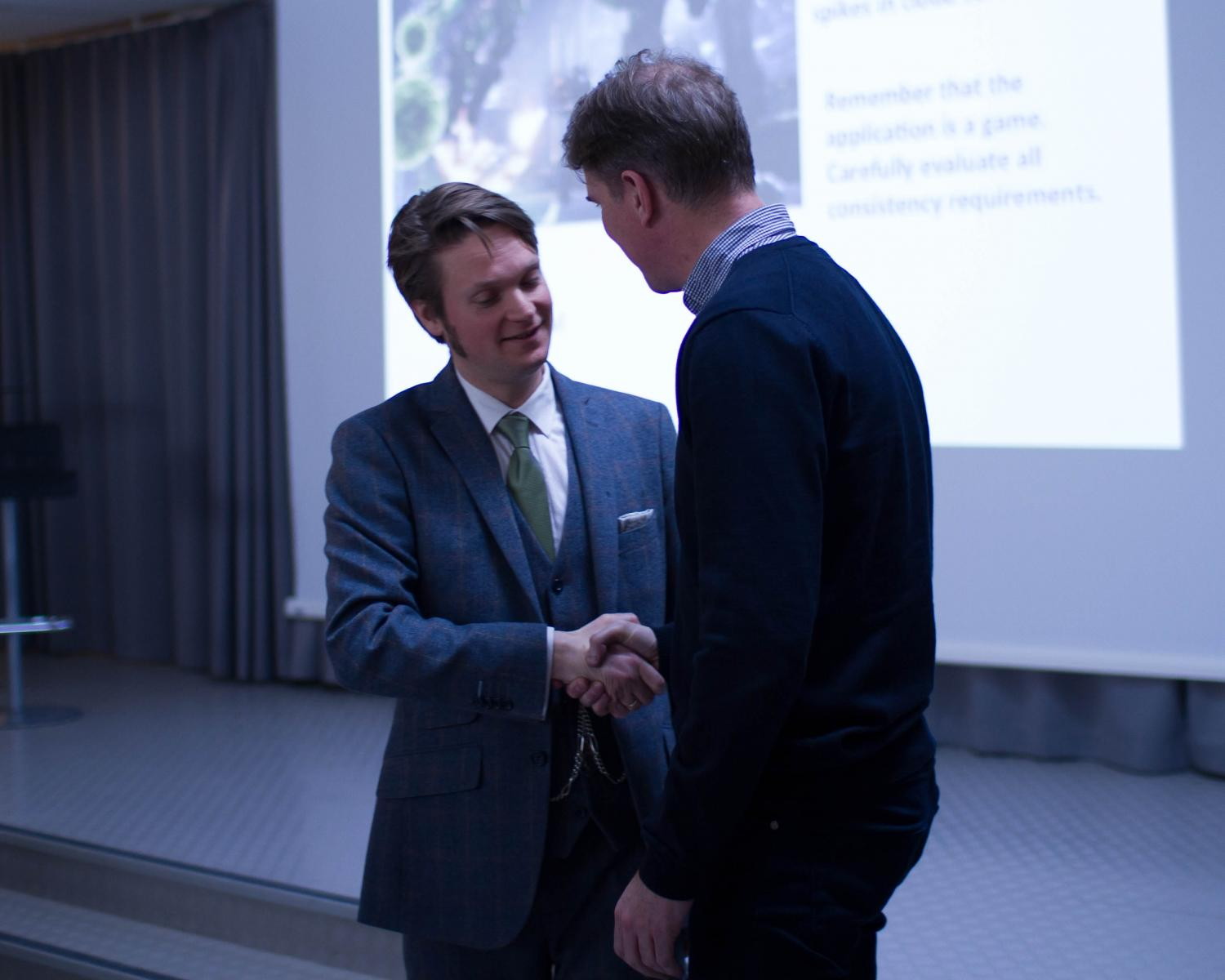 Kjetil Raaen is being congratulated, having defended his PhD